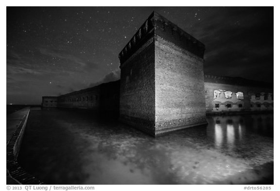 Fort Jefferson corner turret and moat at night. Dry Tortugas National Park (black and white)