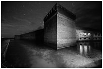 Fort Jefferson corner turret and moat at night. Dry Tortugas National Park, Florida, USA. (black and white)