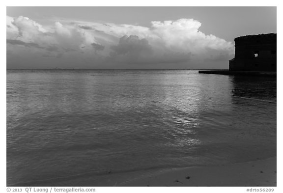 Tropical clouds, beach, and fort at sunrise. Dry Tortugas National Park (black and white)
