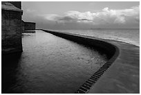 Seawall at sunrise. Dry Tortugas National Park, Florida, USA. (black and white)