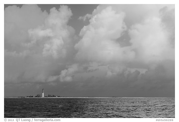 Loggerhead key and lighthouse under tropical clouds. Dry Tortugas National Park (black and white)