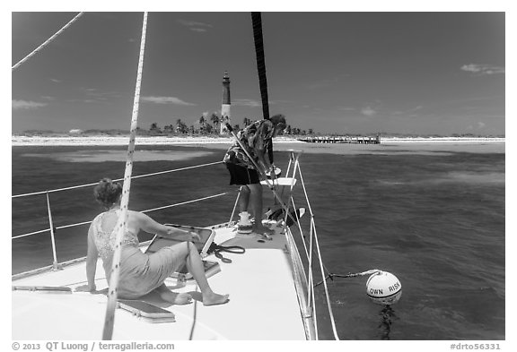 Sailors hooking mooring buoy at Loggerhead Key. Dry Tortugas National Park (black and white)