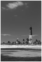 Loggerhead Light, palm trees and turquoise waters. Dry Tortugas National Park, Florida, USA. (black and white)