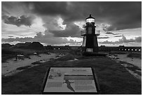Interpretive sign, Harbor Light, and fort Jefferson. Dry Tortugas National Park, Florida, USA. (black and white)