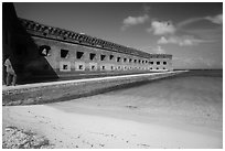 Park visitor looking, North Beach and Fort Jefferson. Dry Tortugas National Park, Florida, USA. (black and white)
