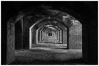 Gallery illuminated by last light inside Fort Jefferson. Dry Tortugas National Park, Florida, USA. (black and white)