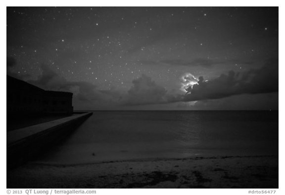 Fort Jefferson and beach at night with cloud electric storm. Dry Tortugas National Park (black and white)