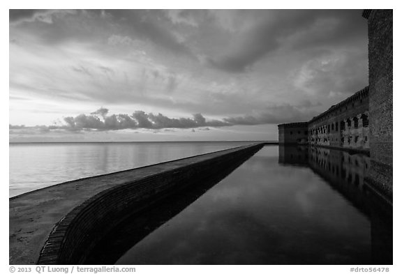 Fort Jefferson seawall, moat and walls at sunset. Dry Tortugas National Park (black and white)