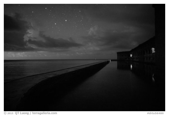 Fort Jefferson at night with stars and light from storm. Dry Tortugas National Park (black and white)