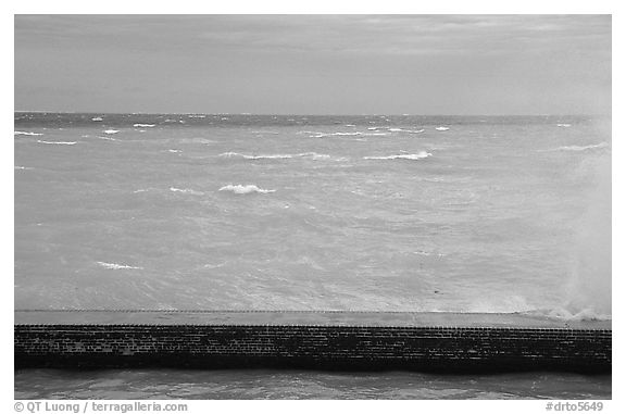 Seawall battered by surf on a stormy day. Dry Tortugas National Park (black and white)