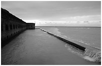 Seawall and moat with waves on stormy day. Dry Tortugas National Park, Florida, USA. (black and white)