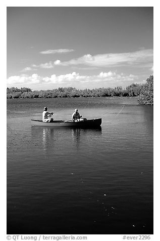 Fishing from a red canoe. Everglades National Park (black and white)