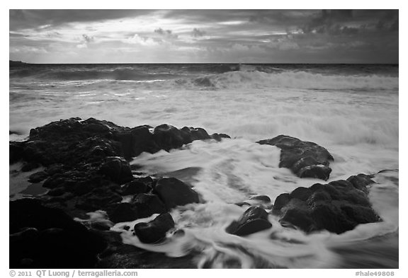 Waves breaking on volcanic rocks. Haleakala National Park (black and white)