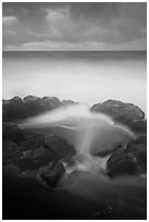 Surf, rocks, ocean and clouds, long exposure. Haleakala National Park, Hawaii, USA. (black and white)