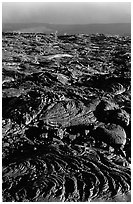 Hardened lava flow and Kaena Point. Hawaii Volcanoes National Park ( black and white)