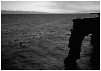 Holei sea arch at sunset. Hawaii Volcanoes National Park, Hawaii, USA. (black and white)