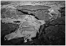 New lava flowing over layer of hardened lava. Hawaii Volcanoes National Park, Hawaii, USA. (black and white)