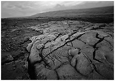 Fresh lava with cracks showing molten lava underneath. Hawaii Volcanoes National Park, Hawaii, USA. (black and white)