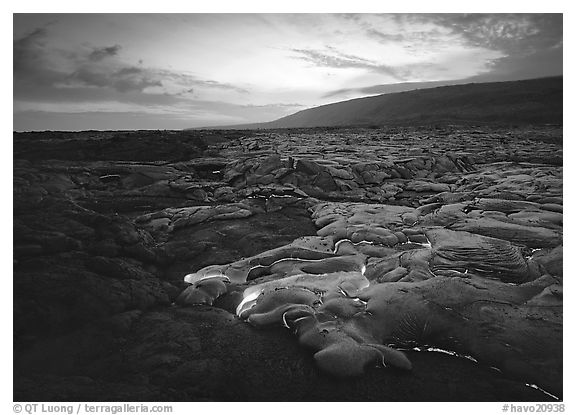 Molten lava flow at sunset near the end of Chain of Craters road. Hawaii Volcanoes National Park (black and white)