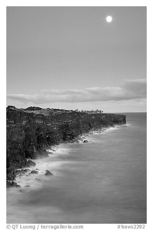 Holei Pali volcanic cliffs and moon at dusk. Hawaii Volcanoes National Park (black and white)