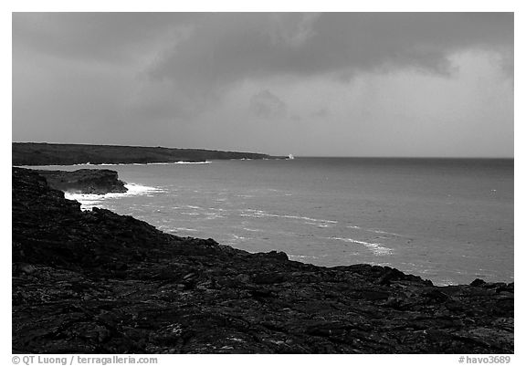 Coast covered with hardened lava and approaching storm. Hawaii Volcanoes National Park (black and white)