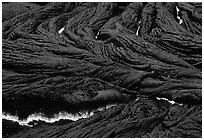 Close-up of ripples of flowing pahoehoe lava at dusk. Hawaii Volcanoes National Park, Hawaii, USA. (black and white)