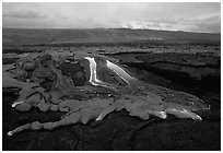 Molten lava flow at dawn on coastal plain. Hawaii Volcanoes National Park, Hawaii, USA. (black and white)