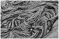 Braids of pahoehoe lava with red hot lava showing through cracks. Hawaii Volcanoes National Park, Hawaii, USA. (black and white)