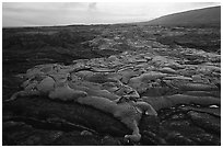 Live lava flow at sunset near the end of Chain of Craters road. Hawaii Volcanoes National Park, Hawaii, USA. (black and white)
