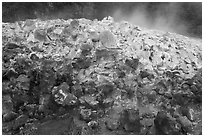 Mound of rocks covered with sulphur from vent. Hawaii Volcanoes National Park, Hawaii, USA. (black and white)
