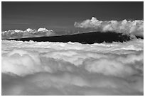 Mauna Loa emerging above clouds. Hawaii Volcanoes National Park, Hawaii, USA. (black and white)