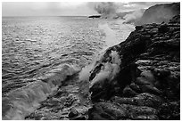 Coastline with lava entering ocean. Hawaii Volcanoes National Park, Hawaii, USA. (black and white)