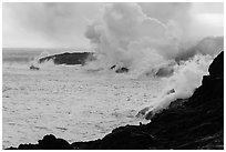 Steam rising off lava flowing into ocean. Hawaii Volcanoes National Park, Hawaii, USA. (black and white)