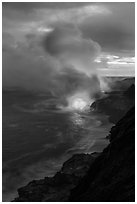 Coastline with steam illuminated by molten lava. Hawaii Volcanoes National Park, Hawaii, USA. (black and white)