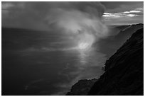 Coastline with steam lit by hot lava. Hawaii Volcanoes National Park, Hawaii, USA. (black and white)