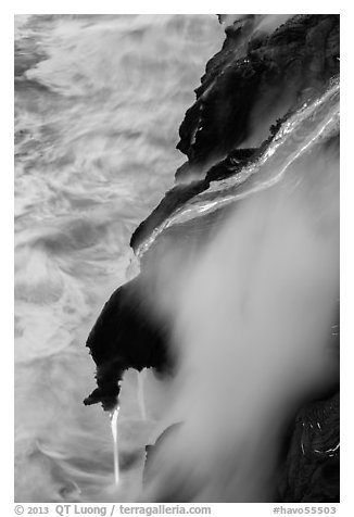 Ribbons of lava flow into the Pacific Ocean. Hawaii Volcanoes National Park (black and white)