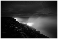 Lava makes contact with ocean on a stary night. Hawaii Volcanoes National Park, Hawaii, USA. (black and white)