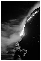 Lava flow entering Pacific Ocean at night. Hawaii Volcanoes National Park, Hawaii, USA. (black and white)