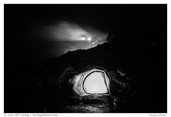Tent and lava ocean entry. Hawaii Volcanoes National Park, Hawaii, USA.