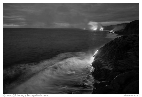 Lava reaching ocean at dawn. Hawaii Volcanoes National Park (black and white)