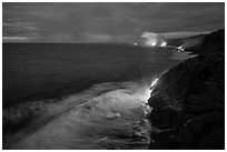 Lava reaching ocean at dawn. Hawaii Volcanoes National Park, Hawaii, USA. (black and white)