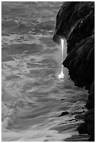 Lava spigot at dawn. Hawaii Volcanoes National Park, Hawaii, USA. (black and white)