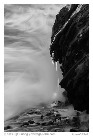 Molten lava drips into the sea. Hawaii Volcanoes National Park (black and white)