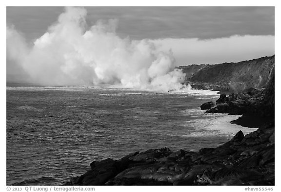 Clouds of smoke and steam produced by lava flowing into ocean. Hawaii Volcanoes National Park (black and white)