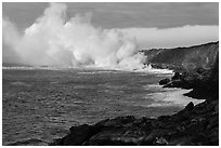 Clouds of smoke and steam produced by lava flowing into ocean. Hawaii Volcanoes National Park, Hawaii, USA. (black and white)