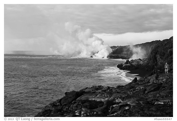 Hiker and volcanic steam cloud on coast. Hawaii Volcanoes National Park (black and white)