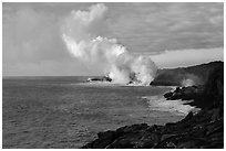 Billowing coastal smoke plume carries toxic sulphur dioxide as lava enters Pacific Ocean. Hawaii Volcanoes National Park, Hawaii, USA. (black and white)