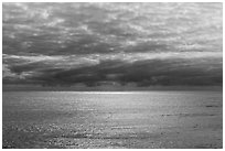 Silvery ocean and clouds, early morning. Hawaii Volcanoes National Park, Hawaii, USA. (black and white)