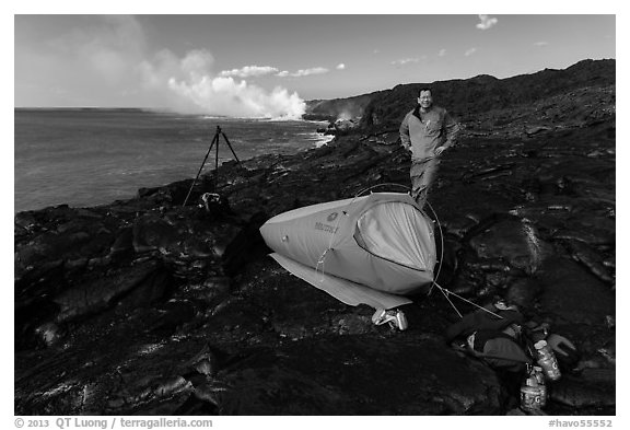 Photographer camping near lava ocean entry. Hawaii Volcanoes National Park (black and white)