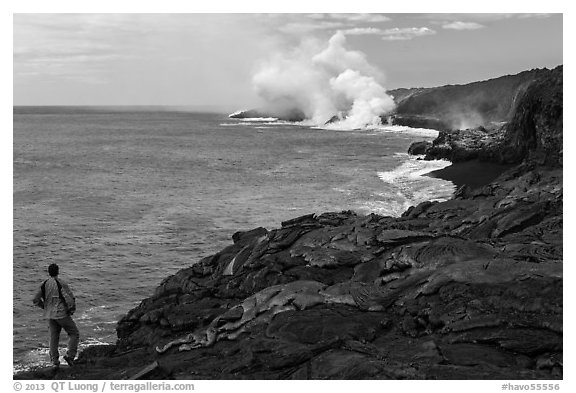 Park visitor looking, lava ocean entry plume. Hawaii Volcanoes National Park (black and white)